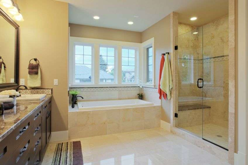 bathroom with granite countertops and flooring